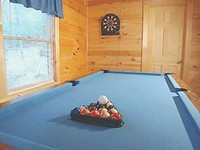 Log Cabin with a  pool table.